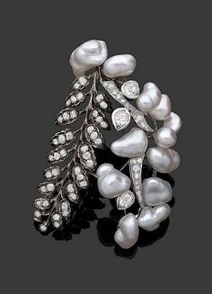 Diamond, baroque cultured pearl platinum and gold brooch, which incorporates a 19th century brooch, by Suzanne Belperron, 1973