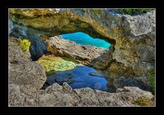 The Grotto at Tobermory, Ontario Canada. Apparently, the Grotto has an underwater cave. You can gain access to the Grotto from Cyprus lake by this cave if your are a good swimmer. The Places Youll Go, Places To See, Places Ive Been, Ontario Camping, Tobermory Ontario, Underwater Caves, O Canada, Quebec, Nice Things
