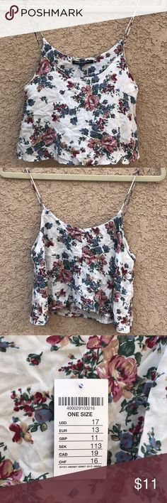 Brandy Melville Floral Crop Top White White Brandy Melville Floral Crop Top; one size; New with tag; 100% Rayon  Bundle deal: 3 items= 15% off   Comment below if you would like the 10% off and getting the $3 off of shipping! Brandy Melville Tops Tank Tops