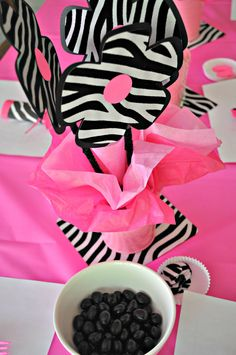 Pink Zebra Baby Shower. Found this on a Google search and they are also here on Pinterest.  I used my Cricut to cut the flowers and covered coat hanger wire with pipe cleaners. Put them in pink metal pails with flower foam and tissue paper.