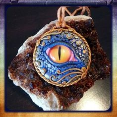 Dragon Eye Amulet - Intuition by JenstoneCreations on DeviantArt Polymer Clay Dragon, Polymer Clay Charms, Polymer Clay Art, Polymer Clay Jewelry, Polymer Clay Projects, Clay Crafts, Diy Jewelry Projects, Jewelry Crafts, Jewelry Ideas