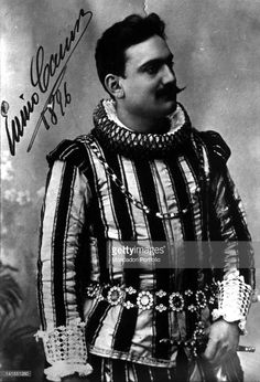 Italian tenor Enrico Caruso wearing a costume and keeping a dagger wit... Show more