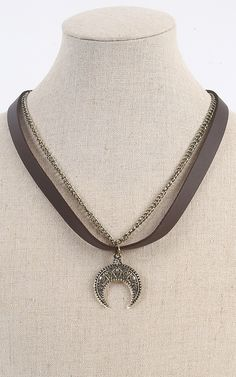 Add this tribal pendant vegan leather necklace to your boho look. It'll be an amazing accent to your whole ensemble. | MakeMeChic.com