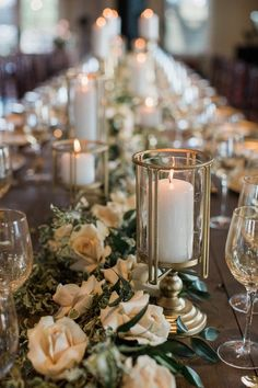 Romantic tablescape idea - lush greenery + white roses with gold candle details {Jennifer Weems Photography}