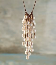 """Clouds come floating into my life,  no longer to carry rain or usher storm,  but to add color to my sunset sky. The """"Rain Storm"""" necklace, 56 pearls showering off fine leather.  Bring it on!"""