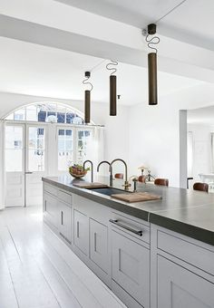 Wonderful wide kitchen with extra counter space - extravagant look and specialised solutions. So perfect!