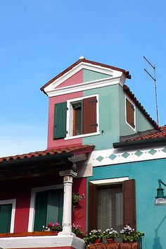 Burano -- this house is not just one bright color, but two -- looks as if it's half and half.
