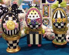 Love the stands for these eggs. Tapestry Fair is the Designer.