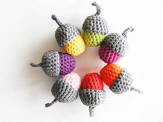acorns - pattern available from PlanetJune http://www.planetjune.com/blog/free-crochet-patterns/amigurumi-acorn or Lion Brand Yarn at http://www.lionbrand.com/patterns/90533AD.html?noImages=