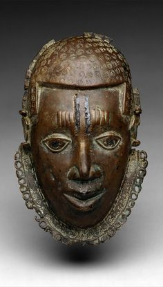 Nigeria | Pectoral mask from the Edo people of the Court of Benin | brass and iron | ca. 15th to 17th century