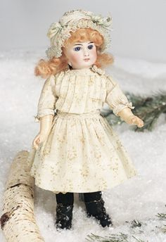 """10"""" Sonneberg Bisque Child Doll by Mystery Maker~~~pierced ears, blonde mohair wig, Sonneberg composition and wooden fully jointed body, antique costume. CONDITION: Bisque excellent, body repainted. MARKS: 3. COMMENTS: Mystery maker, circa 1890."""