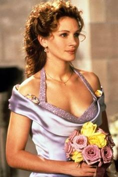 "Julia Roberts has to be one of the most beautiful actresses. She's also not afraid to let her hair be its sometimes-frizzy-curly self. I love that in ""My Best friend's Wedding"" she doesn't straighten it for the wedding. I know a lot of people try to tame their hair by straightening it for big events, but I think curly hair makes a pretty dress look even more regal."