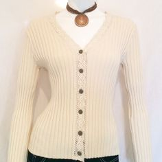 """i.e. Relaxed White V-Neck Sweater. i.e. relaxed cream v-neck long sleeved button downed sweater. Sleeve Length 23, Length of Sweater 22, Armpit to armpit 15.5, V-Neckline 10"""". 100% cotton, knitted in Indonesia. Machine Wash Cold. i.e. relaxed Sweaters V-Necks"""