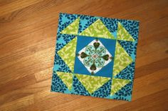 mosaic block by sonnetofthemoon, via Flickr - I have some charms that look like delft tiles...they would look great show-cased like this.