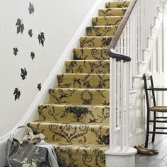 Using a stencil to enhance the stair carpet.  Just love these colors