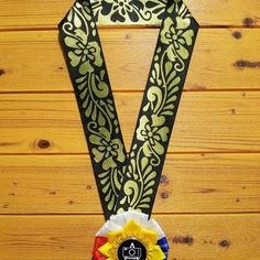 """Letra 'To creates handcrafted rosette leis for guests and delegates. Our """"Kalayaan"""" is our best-seller. American Bully Kennels, Ribbon Lei, Guest Speakers, Leis, Dog Show, Flag Design, Velvet Ribbon, Independence Day, Color Schemes"""