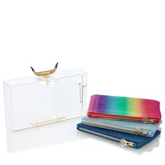Grab Spring/Summer fashion by the horns with the Horny Pandora. This signature Charlotte Olympia perspex clutch box is finished with a bull horn clasp that adds a strong statement to your evening ensembles. Zip your essentials into one of the three cotton inserts.