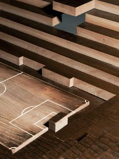 Design Studio Oscar & Ewan was commissioned to build the table for Nike and SHOWstudio's Art of Football exhibit. The stadium plan was waterjet cut into the table top and each layer was lowered down in towards the center. An old Anglepoise lamp was used to mimic stadium floodlighting.