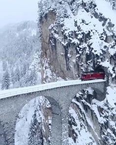 The Glacier Express through Landwasser Viaduct Switzerland . Glacier Express Switzerland, Beautiful Places To Travel, Swiss Alps, Train Rides, Fauna, Winter Travel, Bora Bora, Vacation Trips, Places To Go