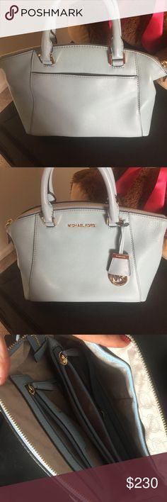 Michael Kors Saffiano Leather Purse Light blue medium size saffiano leather that is in perfect condition. Has been used once, but my style has changed and someone deserves this beautiful purse! KORS Michael Kors Bags Satchels