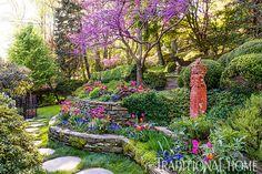 A terraced landscape out of necessity became the canvas for a vibrant backyard garden. - Photo: Rob Cardillo