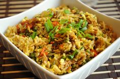 BEST EVER VEGAN FRIED RICE WITH SCRAMBLED TOFU recipe can be made with some kind of meat. Instead of fried egg,  scrambled tofu is added, which gives the dish that yellow colour that cooked eggs do.