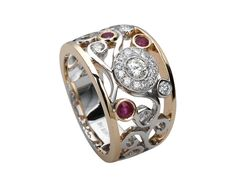 O.K. so THIS is what I really want - An abstract diamond & ruby two tone gold ring.