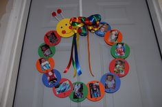 Baby Einstein caterpillar wreath for Luke's 1st birthday party- a picture from each month of his1st year!
