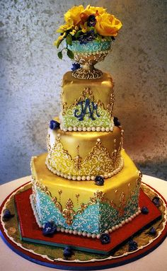 Tiered cake decorated in French Rococo style.