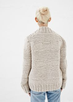 Oversized, long-sleeved hand-knit cardigan in a natural alpaca blend. Shawl collar. Button closure. Seam pockets. Higher knit detail in horizontal stripe pattern throughout. Delicate dry clean.
