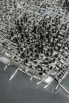 type city by hong seon jang; old lead type has been salvaged from decommissioned printing presses and formed the building blocks for a high rise and imagined city.