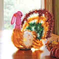 Instantly ready your home for the holidays with this lighted Turkey Centerpiece. Solutions.com #Thanksgiving #Turkey