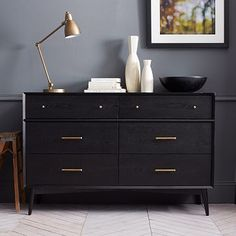 a black IKEA Malm dresser with brass handles and little knobs on tall legs is a chic mid century modern piece of furniture Hack Commode Ikea, Ikea Dresser Hack, Dresser Drawers, Dresser As Nightstand, Dresser Pulls, West Elm Dresser, Dresser Ideas, Knobs For Dressers, Ikea Hack Bedroom