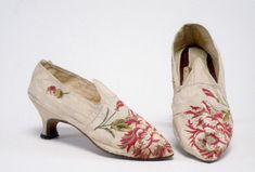 1775-1795 Shoes are made of ivory ribbed silk with large red and white flower brocade at the toe. The heels are thin and 2 1/4 inch, covered with white silk. Shoes have a pointed toe. Historic New England