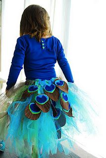 A DIY peacock outfit! The same idea could also create an amazing tablecloth for a peacock party table...