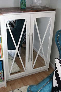 DIY tutorial: how to add mirror doors to IKEA Billy Bookcases and decorate them with a pretty X {I Heart Organizing}