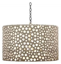 This would be such an easy DIY project with a regular lampshade and some rhinestone embellishments