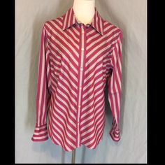 NWOT Jones New York Button Down Career Blouse New Without Tags, no defects. Rose pink with navy, white and rose stripes.Button placket, inside collar and cuffs are in a navy stripe pattern. 100% Cotton. Two button cuffs. Bust 25 inches flat. Length 27.5 inches. Jones New York Tops Button Down Shirts