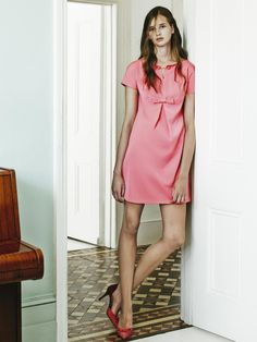 SCEE: Chain dress and two-tone court shoes