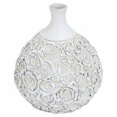 """Ceramic vase with embossed rosettes and a narrow neck.   Product: VaseConstruction Material: CeramicColor: WhiteDimensions: 12"""" H x 11"""" Diameter"""