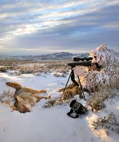 A Hunter Wearing Realtree Ap Snow Camo Rests On One Knee