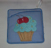 A Pot holder made with a cupcake design - this is an In-the-Hoope project