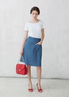 Simple a-line skirt, white top, and red shoes. Simple makeup and hair. Love it.