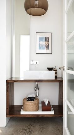 open vanity, smokey light fixture in small bath