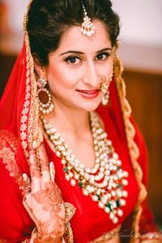 Meet The Bride - Natalia | WedMeGood The Gorgeous Bride Natalia - Minimalistic Makeup, Simply Beautiful Red Lehenga and Some Polki Pearls Jewellery Set. Photo Courtesy - Tarun Chawla #wedmegood #wmgbride #bride
