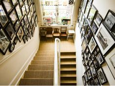 belgian stairwell: mix-matched chairs and gallery walls