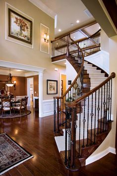 Traditional Staircase with Wall sconce, Crown molding, Carpet, High ceiling, Wainscoting, Hardwood floors