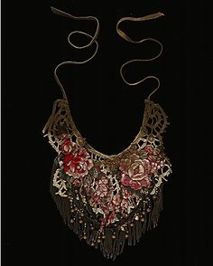 crochet:    Flower Lace Necklace  beaded neckpiece with 19th century Victorian flower embroidery…This unique neckpiece has been made entirely by hand from antique materials. It features 19th century silk floral embroidery in dusky pinks and faded greens. Threaded onto the subtle gold crochet underlayer are long brass coils and antique wooden beads, creating a dense, tactile fringing.