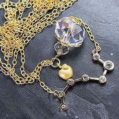 """Double- strands necklace, with long and short chains, big crystal pendant, """"apple"""" charm and unusual pendant """"Big Dipper""""."""