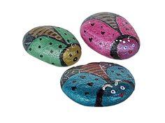 Painted bug rocks that use metallic craft paint gleam like little jewels